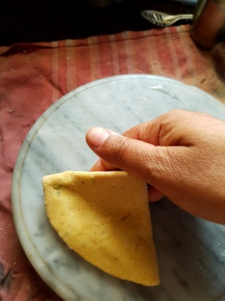 Roll the folded chapati again