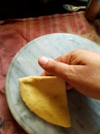 Roll the folded chapati again